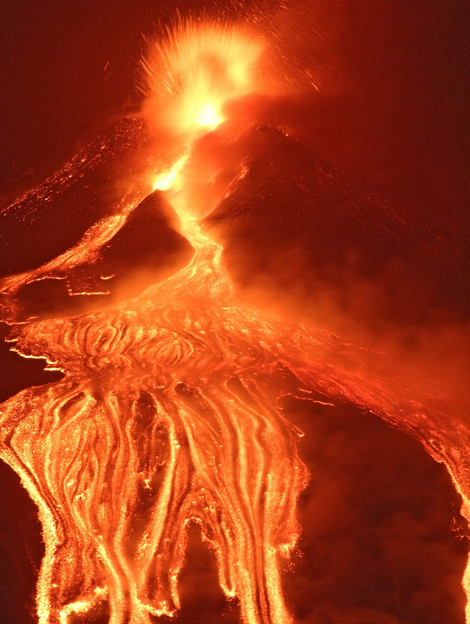 Spectacular: Mount Etna appears to almost crack open as it emits lava from the Earth's core