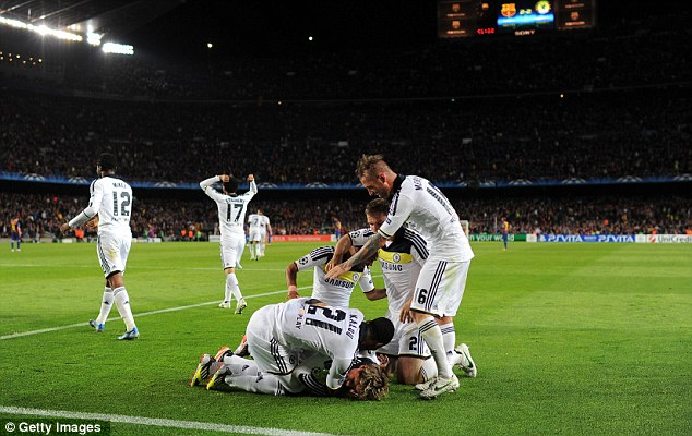 Blue is the colour! Chelsea celebrate after Torres' late goal rounded off a memorable night for the west Londoners