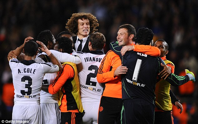 Pure delight: Chelsea players and staff race onto the pitch on the full time whistle