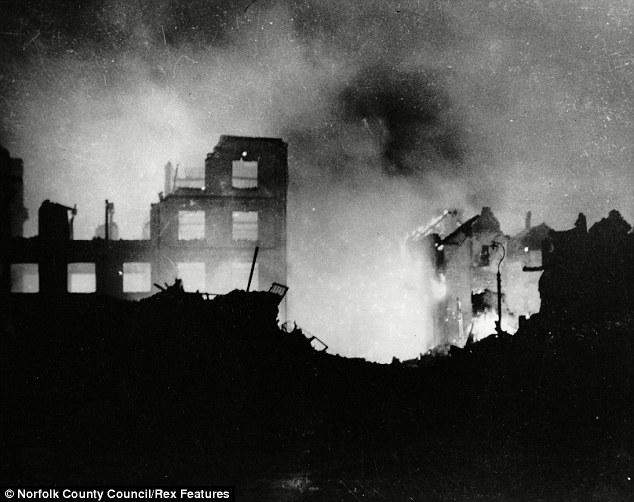 Destruction: The Wincarnis works in Westwick Street ablaze following one of the Luftwaffe's raids