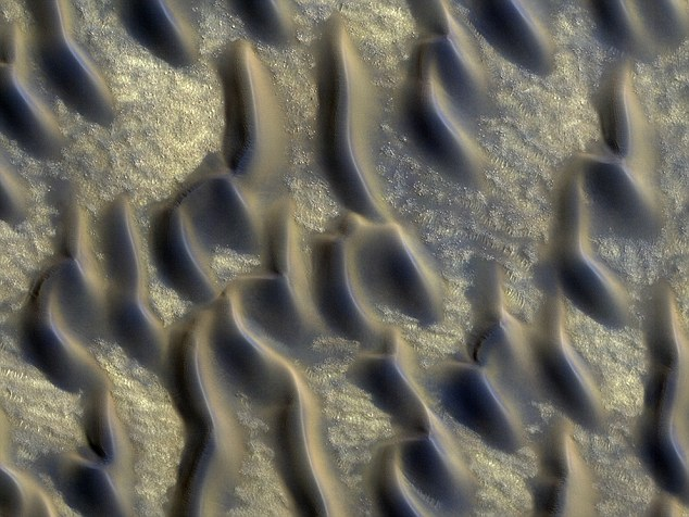 Martians, of course, are not peering at us through double-glazing - instead, the glass sand that covers Mars is evidence of lava interacting with ice or water, an ideal recipe for the creation of life