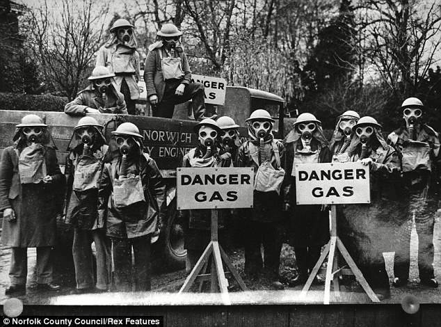 At the ready: One of the city coporation's gas decontamination squads prepare for the air raids