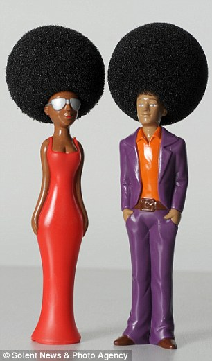 Fans of Disco music can 'get down with the dishes' with this washing-up sponge made to look like an Afro haircut
