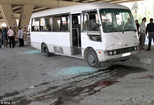 A damaged bus in Damascus, Syria, thought to be caught up in a 'suicide bomb' attack