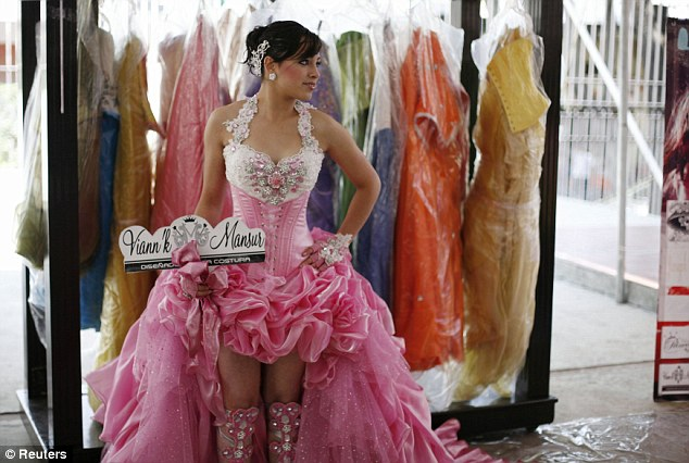 Preparation: A girl poses in an evening dress during a dress rehearsal with other girls for their upcoming 15th birthday celebrations in Mexico City on April 21, 2012