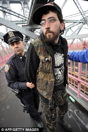A New York City Police Department officer arrests an Occupy Wall Street protester on the Williamsburg Bridge