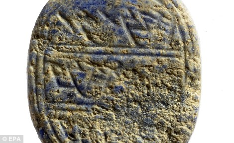 Sign of the times: Archaelogists have discovered this small stone engraved with the name 'Matanayahu' which they believe was used to stamp letters with the owners mark 2,700 years ago