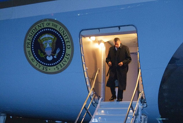 Arrival: Obama, pictured leaving Air Force One, is in Afghanistan exactly one year after the death of bin Laden