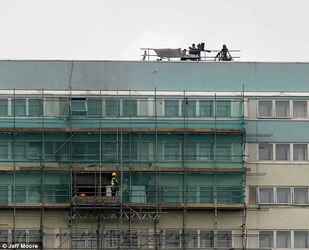 Defence: The surface-to-air missile on top of the Waltham Forest tower block are one of a link of armaments designed to create a ring of steel around the Olympic site