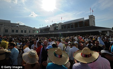Packed event: Earlier in the day, thousands had gathered at Churchill Downs to watch the racing
