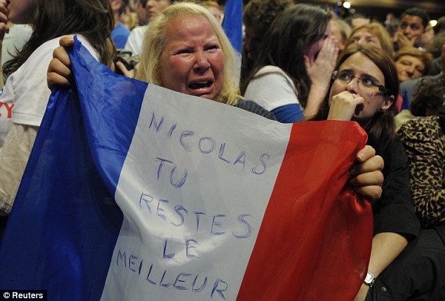 And the losers: A distraught supporter of Sarkozy's UMP party reacts to the early results at the Mutualite meeting hall in Paris