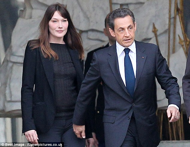 Ousted: Sarkozy and his wife Carla Bruni leave the Elysee Palace, the official residence of the president, after his election defeat