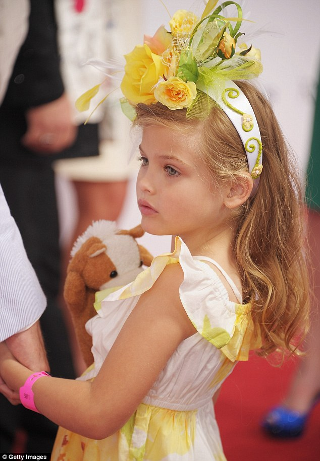 Such a beautiful flower: Dannielynn Birkhead was a credit to her late mother, Anna Nicole Smith, at the 138th Kentucky Derby at Churchill Downs yesterday