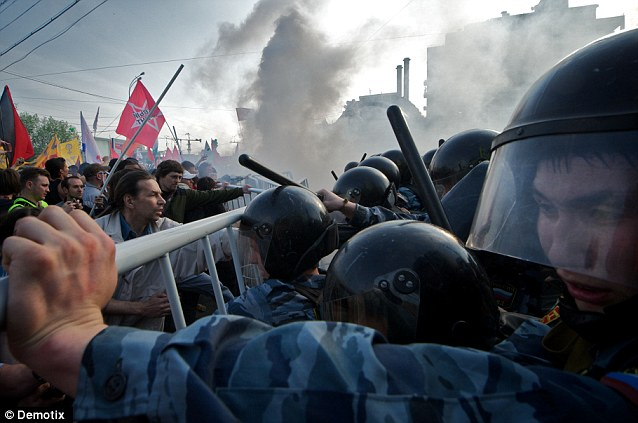 Chaos: Violence erupted between 20,000 demonstrators and riot police Moscow on the eve of Vladimir Putin's inauguration as president