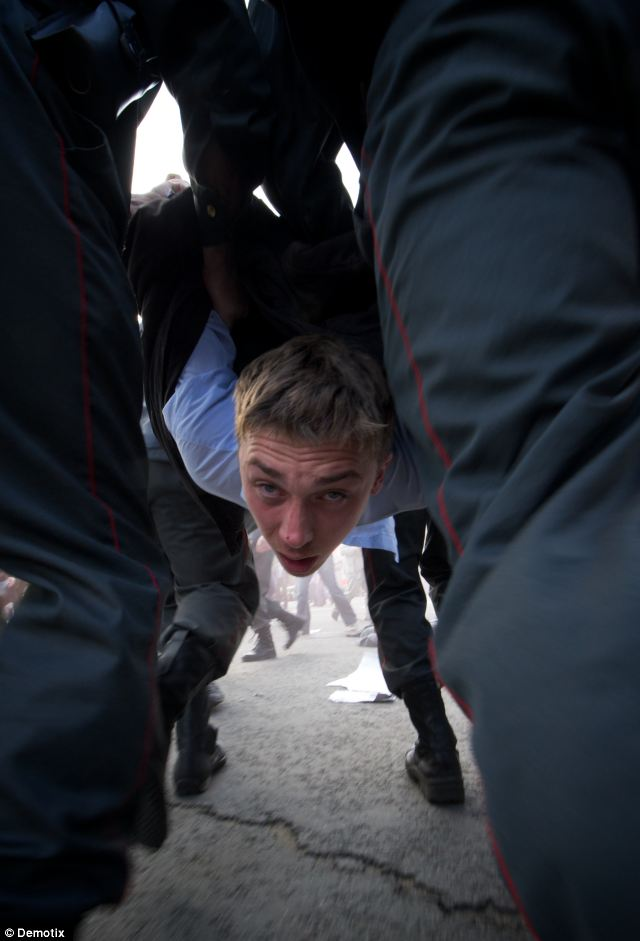 Arrests: Russian officials said they may file criminal charges against those in custody after 12 riot police officers were hurt