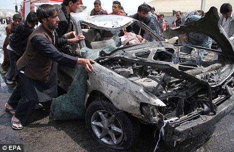 Continued attacks: A suicide bomber detonated a car filled with explosives in Kabul - killing at least six people
