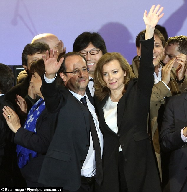 All smiles: The couple acknowledge supporters after victory in the French Presidential Elections at La Bastille