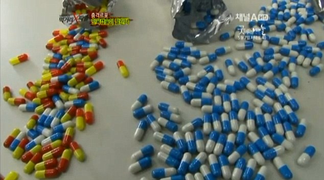 Gruesome: These brightly-coloured pills hide a horrific inside - the remains of dead babies