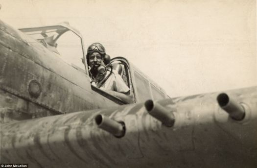 Reading for combat: Flt Sgt Copping proudly looks down from the cockpit of his Kittyhawk P-40