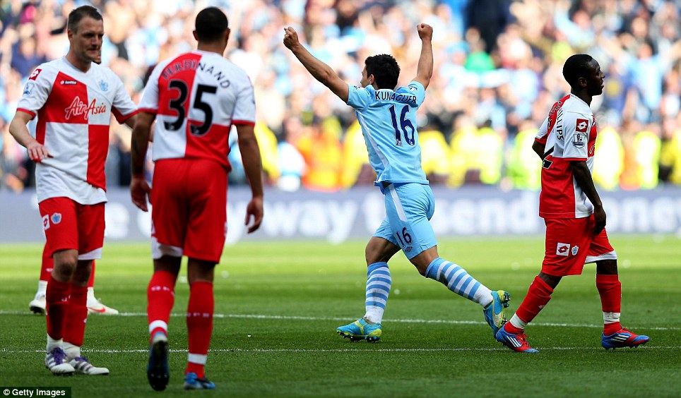 Incredible: Goal hero Sergio Aguero celebrates winning the title at the final whistle