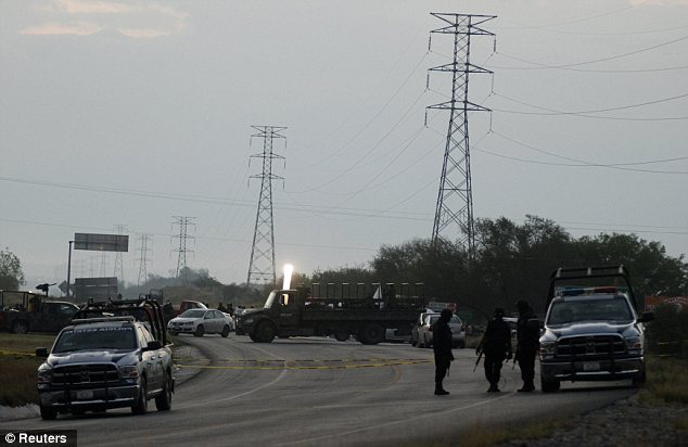 Authorities closed off the highway, blocking the way for hundreds of motorists, as federal and state police, joined by Mexican troops, sealed off the scene