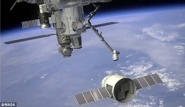 An artists view of the space station's robotic arm reaching out to grab SpaceX's Dragon capsule which will happen if all goes according to plan after this Saturday's launch