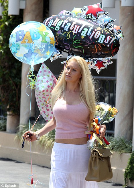 Heidi Montag Squeezes Her Ample Bosom Into Tight Sweater