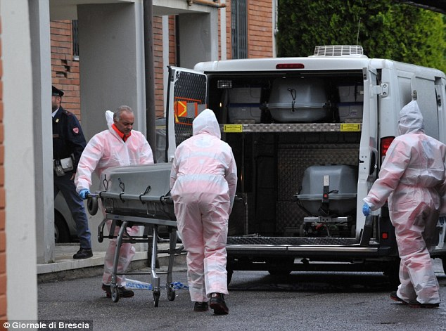 Tragic: The body of Marco Turrini is taken away after he killed his two children and then himself in Brescia