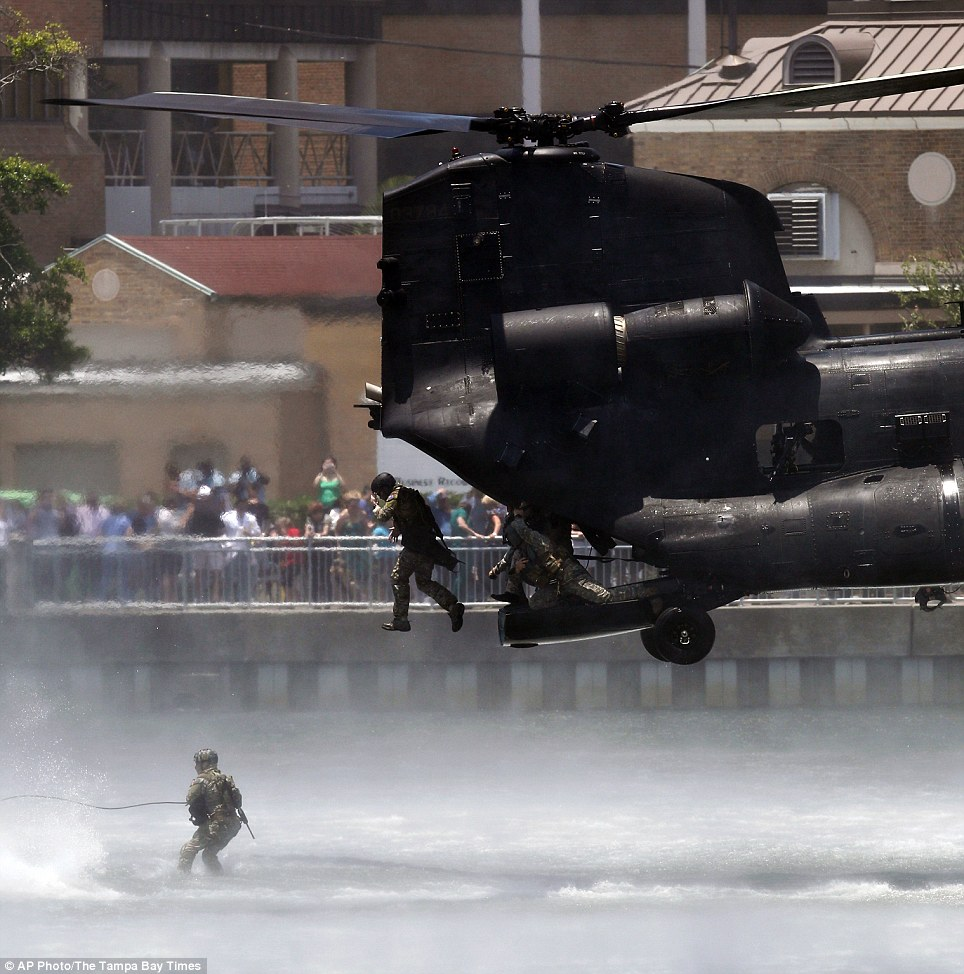 Special operations forces jump from an Army MH-47 Chinook into water during the dramatic training exercise which looked like the scene of a film