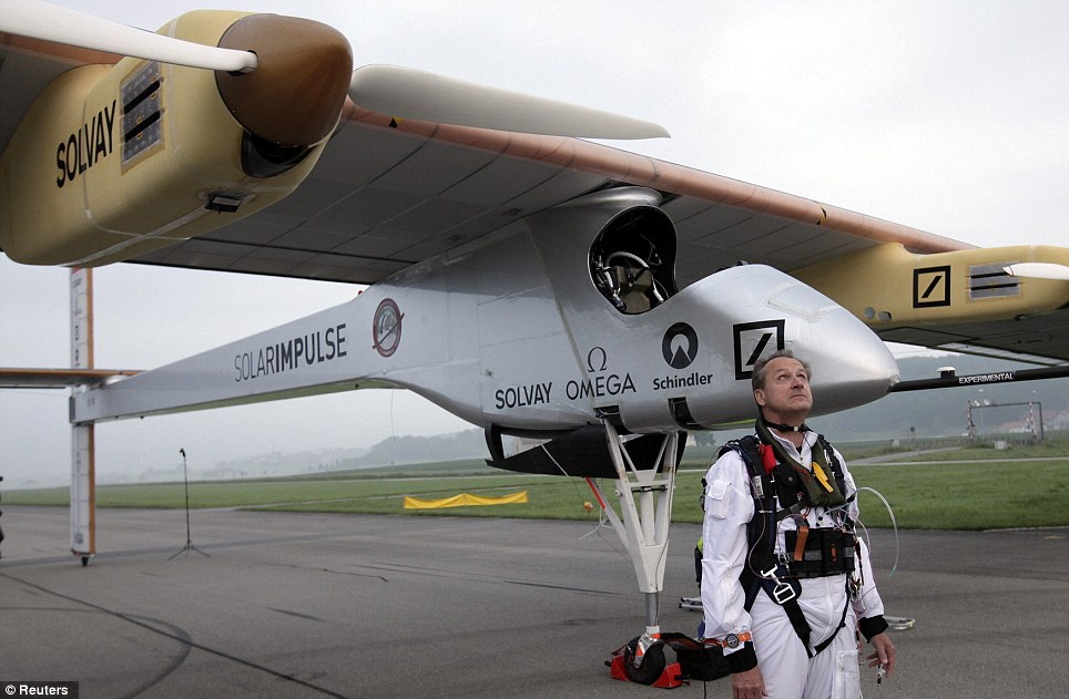 Looking up: Solar Impulse founder and pilot Andre Borschberg looks at the sky before take-off