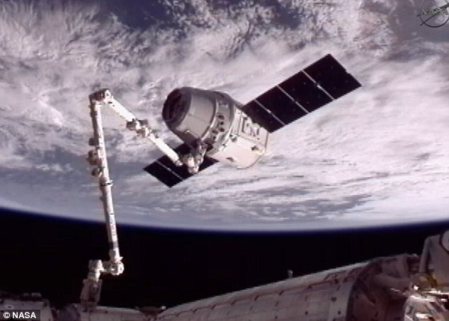 Docked! The ISS and the Dragon capsule are now as one, following the historic docking