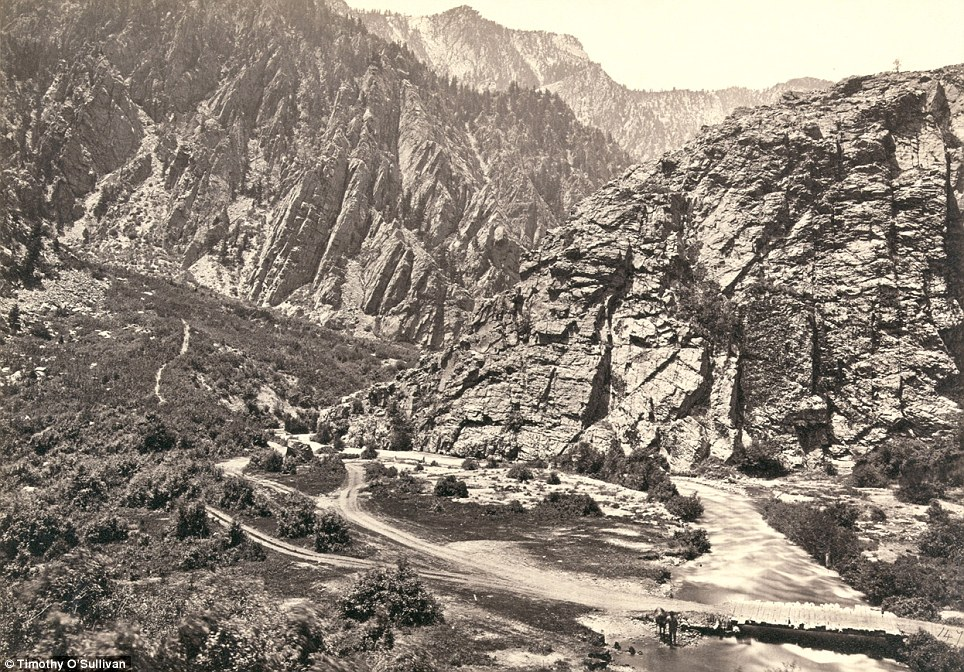 Mountains: Big Cottonwood Canyon, Utah, in 1869. A man can be seen with his horse at the bottom near the bridge (right)