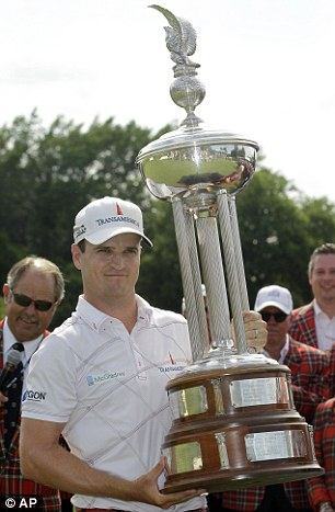 Champ: Johnson shows off his trophy