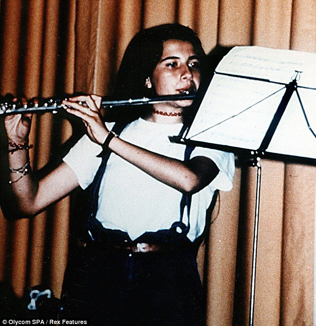The family of Emanuela, pictured playing the flute, are waiting to hear if the tests confirm the bones are those of the schoolgirl, who disappeared in the summer of 1983