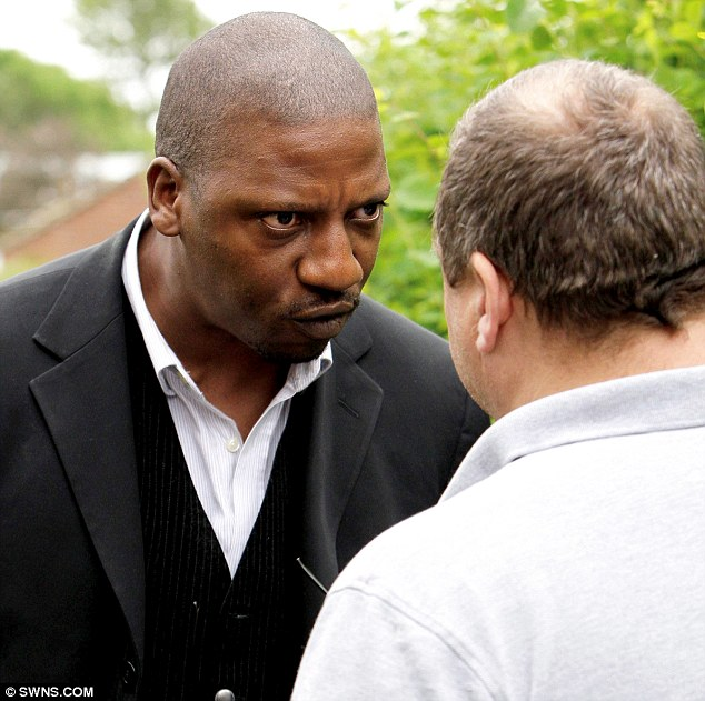 Confrontation: Jonathan King, (left) the eldest son of dog owner Garfield King clashes with Dave Guess, grandfather of dog attack victim Kieron Guess today