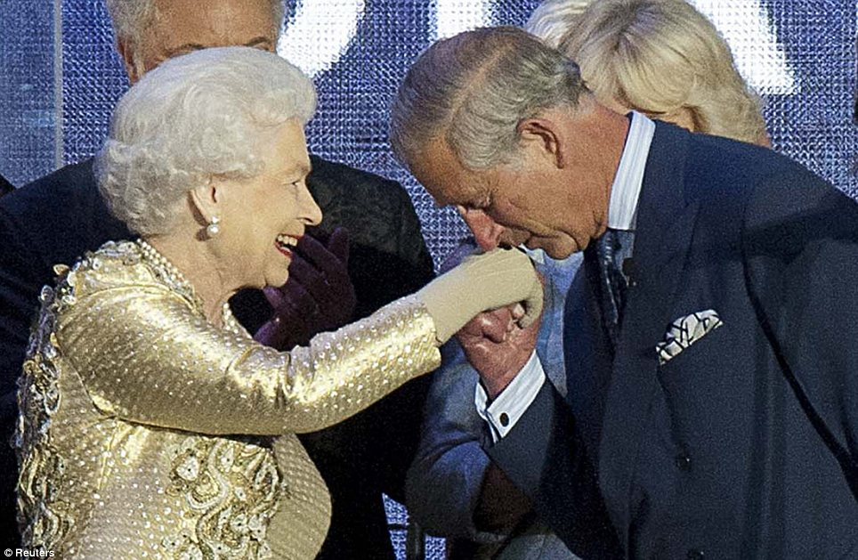 Thrilled: Prince Charles kisses the Queen's hand much to her delight
