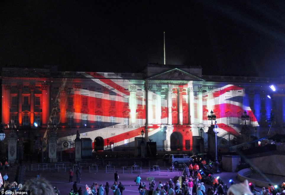 Proud to be British: A stunning Union Jack lights up the palace