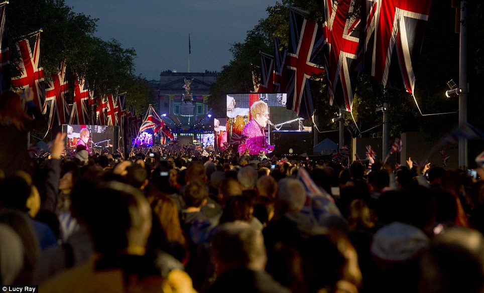 Royal approval: Sir Elton John performing on the big screens which were relaying the concert live to the crowds which lined the Mall, St James's Park and Hyde Park