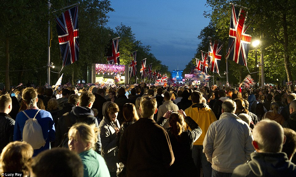 Patriotic: The capital came together in the streets and parks surrounding Buckingham Palace in a show of community cohesion for as far as the eye could see