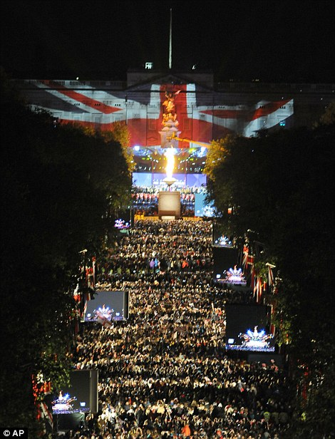 A beacon is lit outside Buckingham Palace to mark the end of the Jubilee concert