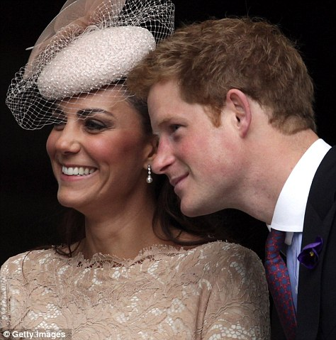 Duchess of Cambridge and Prince Harry smile