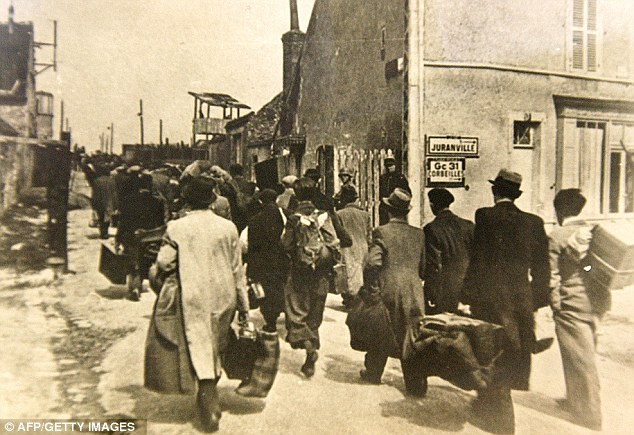 Captives: Jewish people arriving at the transit camp of Pithiviers, near Orleans, where they were placed under French police supervision before being transported to concentration camps