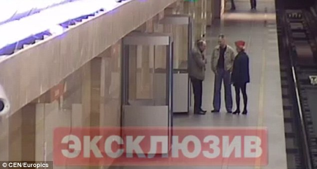 Argument: This CCTV footage was captured from a Metro track in St Petersburg, Russia. It shows Yevgeny Borodin, left, arguing with a female worker, which, at first, appears under control