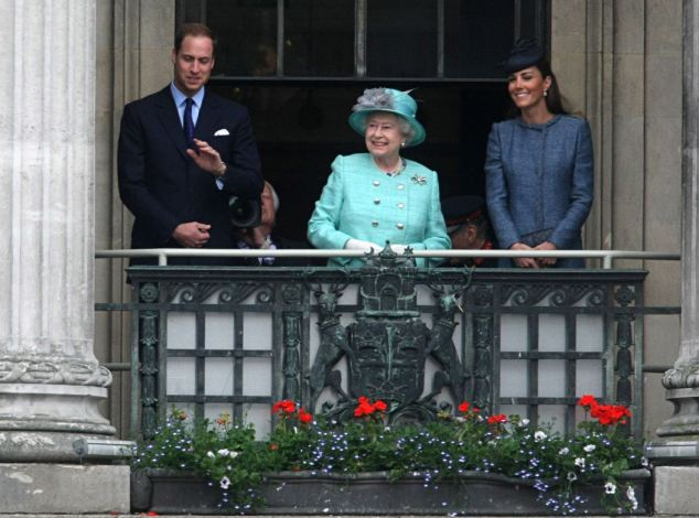 Grand occasion: The royals smiled and waved while 35,000 well-wishers cheered and waved flags for the elegant trio