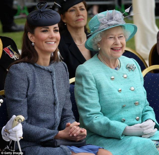 Two peas in a pod: Kate and the Queen sit with their hands clasped in their laps as they smile at the celebrations in Vernon Park