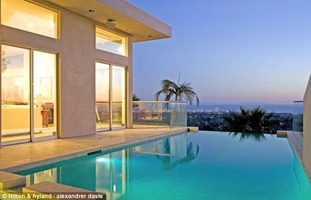 The hills: The luxury house with four bedrooms and four baths has a stunning view over the city