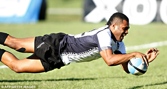 Too little: Fiji's winger Metuisela Talebula dives over for as try against Scotland