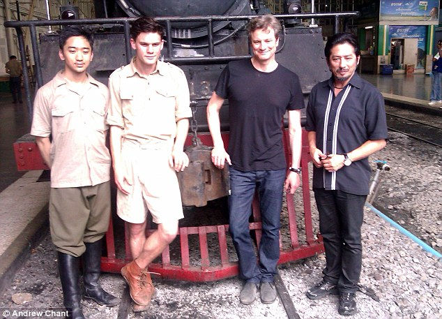 Stars from The Railway Man Jeremy Irvine, second left, with Colin Firth, second right, and Tanroh Ishida, far left and Hiroyuki Sonada pose in front of a steam train at Hualamphong train station, Bangkok