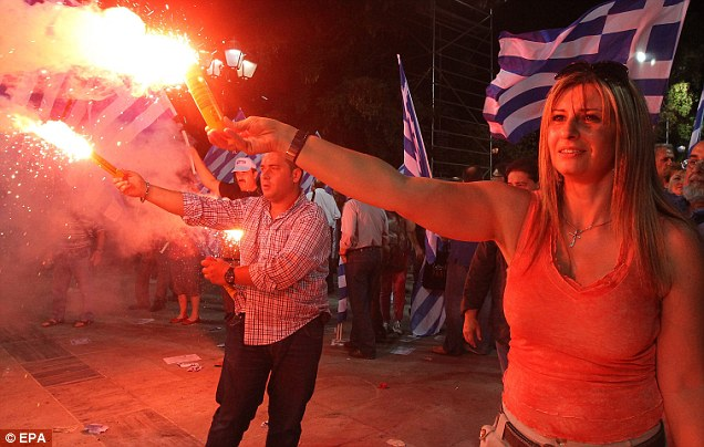 Burning issue: The Greek election could see the country pulling out of the eurozone, which would have huge ramifications elsewhere, warn European leaders
