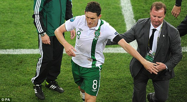 Off: Keith Andrews is escorted from the pitch after his red card